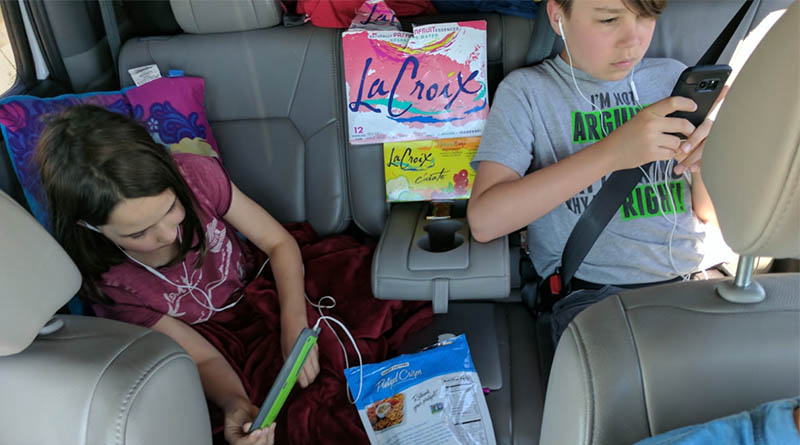 The back seat of our Honda Pilot in Texas in 2017. Chaos!