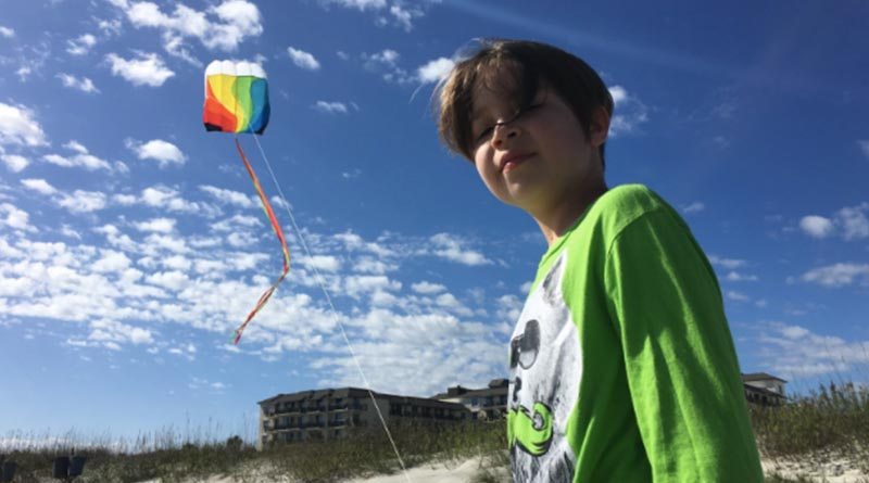 Iden Elliott flies a kite on Jekyll Island in 2015. When people visit Orlando, they don't think of this Georgia island. But it's close -- and affordable.